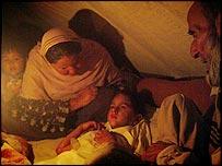 Family of Shameer Shah Jehan (C) in Balakot