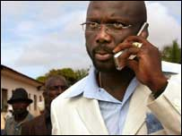 Weah talks on a mobile phone during the election campaign