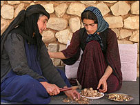 Hedieh and her mother shelling walnuts