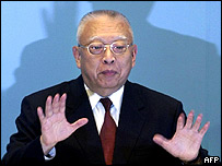 Tung Chee-hwa at his resignation news conference