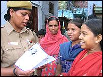 Female police talking to women