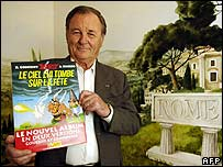 Asterix illustrator Albert Uderzo with his new book