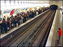 Commuters wait for trains in Paris Metro