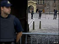 Police guard parliament buildings in The Hague during the operation