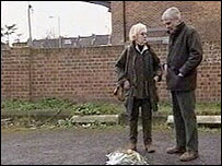 Isobel Hulsmann and Alastair Morgan lay flowers at the murder scene in March 2005