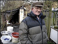 Harry Hallowes in front of his shack