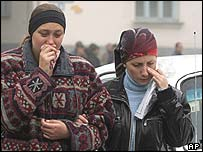 Two local residents mourn the dead in Nalchik