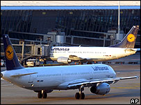 Lufthansa aircraft passes another aircraft where passengers have refused to disembark