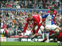 Liverpool's Peter Crouch, Blackburn's Zura Khizanishvili and Djibril Cisse of Liverpool