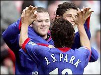 Wayne Rooney (left) celebrates scoring with Ji-Sung Park and Cristiano Ronaldo
