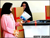 An Iraqi woman casts her ballot in the city of Basra.