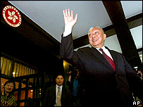 Hong Kong's Chief Executive Tung Chee-hwa bids farewell to reporters as he leaves Hong Kong government headquarters one day after Tung announced his resignation Friday March 11, 2005