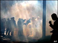 Police use tear gas against an unruly group of protestors in Toledo, Ohio