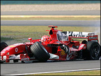 Michael Schumacher tries to steer his car after his warm-lap collision