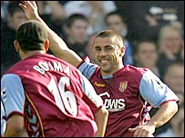 Aston Villa's Kevin Phillips celebrates the opening goal