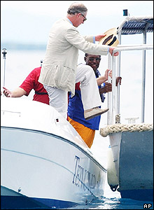 Prince Charles climbed onto a glass-bottomed boat off Castaway Island