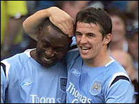 Andy Cole (left) celebrates scoring with team-mate Joey Barton
