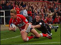 Liam Davies crosses for a try on his first Scarlets start