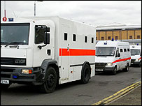 Vans transporting the five suspects from Belmarsh