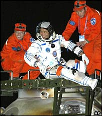 Chinese astronaut Nie Haisheng gets out of the re-entry capsule