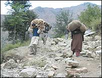 Villagers carrying relief in Tangdar