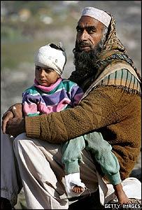Injured child and elderly man in Balakot