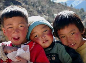 Photo of three Sherpa children with smiling faces