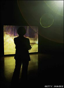 A female visitor looks at Darren Almond's installation.