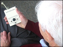 Man holds the Assistive Mouse Adapter (Image: IBM)