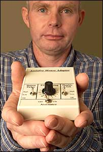 IBM researcher Jim Levine holds the Assistive Mouse Adapter (Image: IBM)