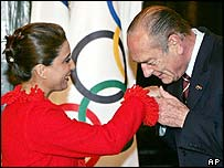 Jacques Chirac greets International Olympic Committee inspection panel chairwoman Nawal El Moutawakel, of Morocco