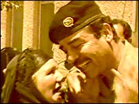 Saddam Hussein kisses a woman in Dujail (1982 TV footage)