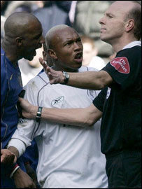 El-Hadji Diouf (centre) protests to referee Steve Bennett