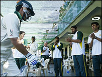 Kamran Akmal returns to the pavilion after his maiden Test century