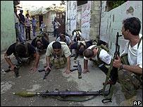 Palestinian militiamen train in the alleyways of Ayn Hilwa camp in Simon