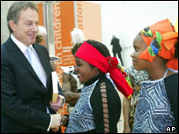 UK Prime Minister Tony Blair meets members of a traditional African choir in London