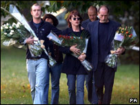 From left, Jody's brother Jake, mother Sheri and her partner Mike Haddock, lay flowers at Clapham Common