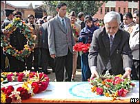 Chief Minister Mufti Mohammad Syeed placing flowers on the coffin of Mr Lone