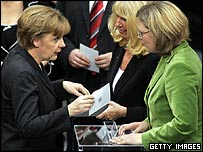 Chancellor-in-waiting Angela Merkel votes for the new speaker