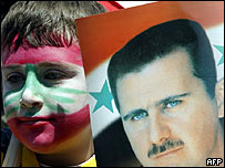 Boy painted in the Lebanese national colours at pro-Syrian rally