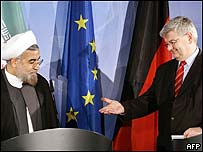 Iran negotiator Hassan Rowhani and German Foreign Minister Joschka Fischer