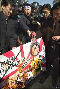 South Korean protesters burn a placard of Prime Minister Junichiro Koizumi during a rally Monday, March 14, 2005.