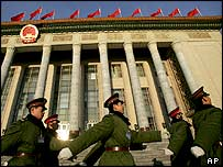 Chinese soldiers march past Beijing's Great Hall of the People