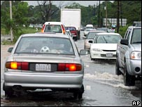 Cars navigate floodwaters in Kingston, Jamaica