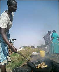 Celine Akini frying Nile Perch