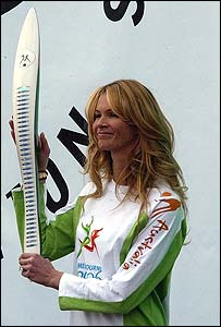 Elle McPherson holds the Commonwealth baton