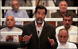 Saddam Hussein and his co-defendants in court