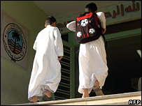 Two Saudi children enter their school in Dammam