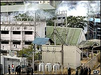 Smoke billows from the detention cell of Camp Bagong Diwa in Taguig, south of Manila, Philippines after tear gas were fired during an assault Tuesday March 15, 2005