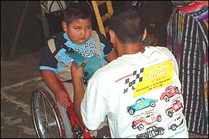 Junior Fernandez being fitted for a wheelchair